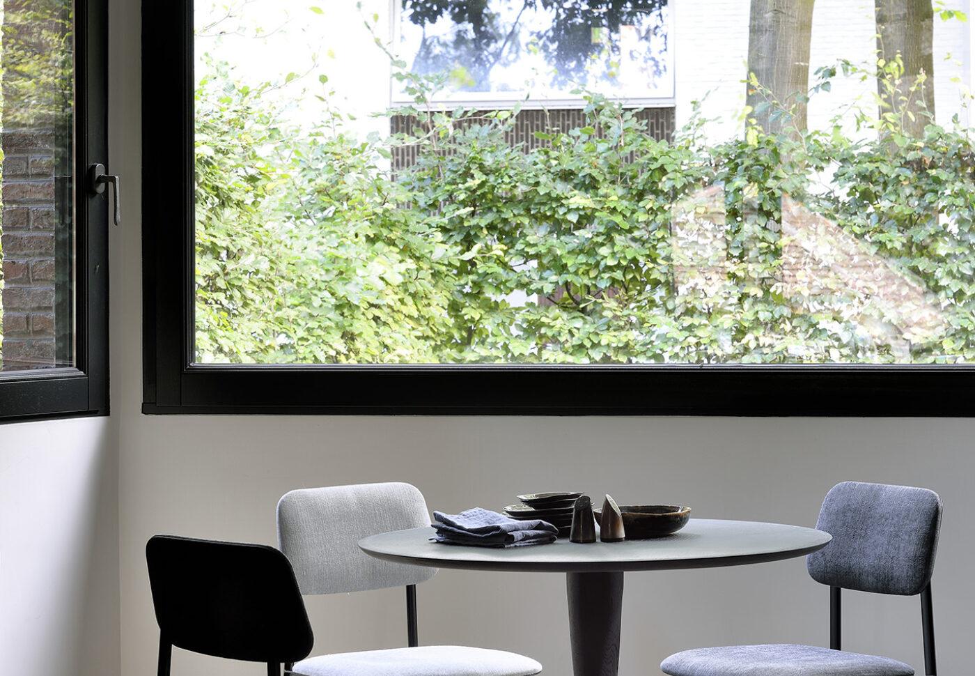 50011 Black Oak Torsion dining table 60078 DC chair dark grey 60079 DC chair light grey 60080 DC chair dark blue